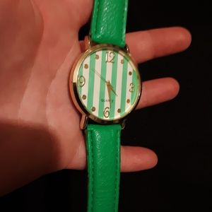 Green and White Accutime watch